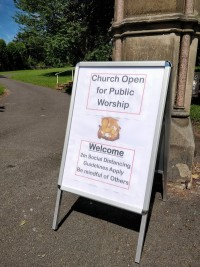 Sign saying Church Open for Public Worship